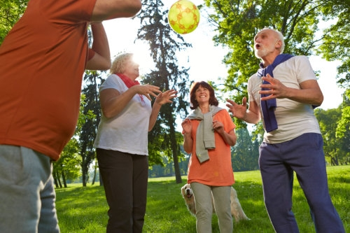elderly couples playing ball
